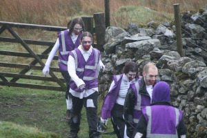 A monster crew return to base wearing purple